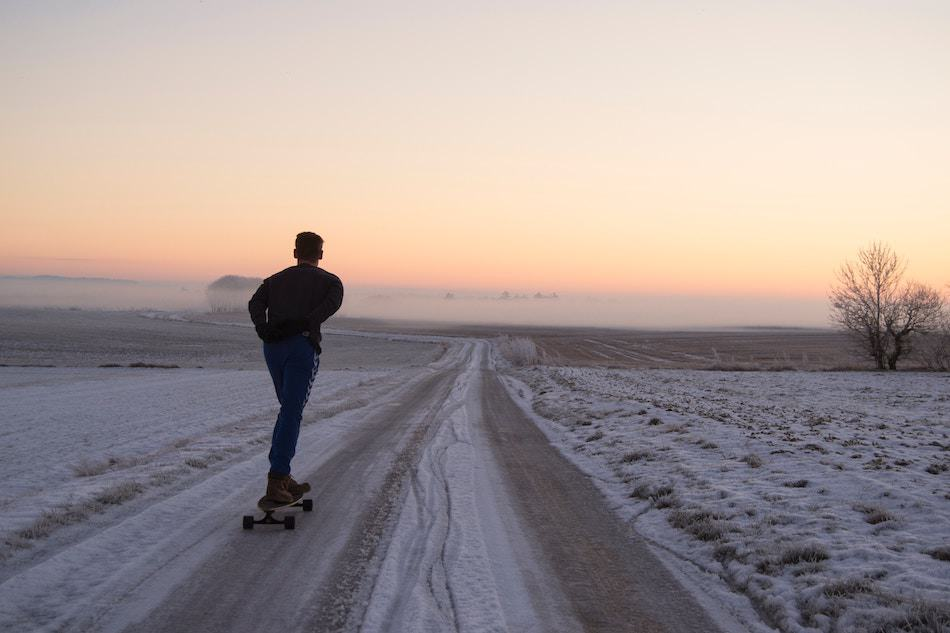 Man Longboarding in the snow